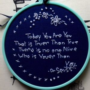 round blue textile art work - Dr Seuss quote